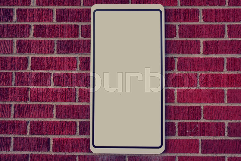 Red brick wall with blank sign, stock photo