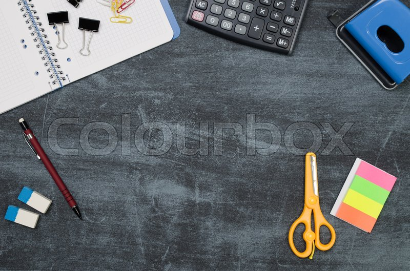 Business desk in office top view. Table with calculator, notepad, and office supplies. Copy space website banner concept, stock photo