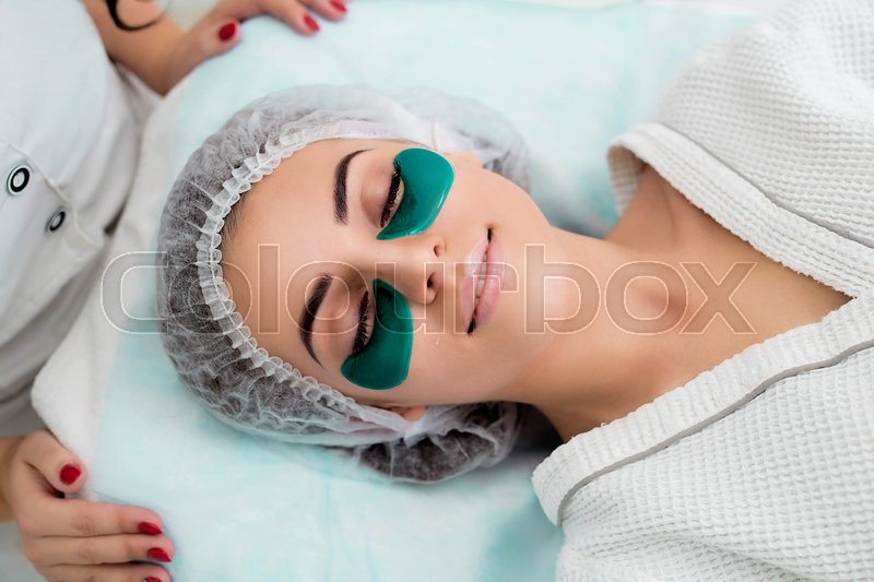 Acupressure, massage his temples, green ... | Stock image ...