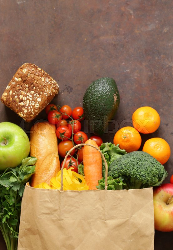Grocery food shopping bag - vegetables, fruits, bread and pasta, stock photo