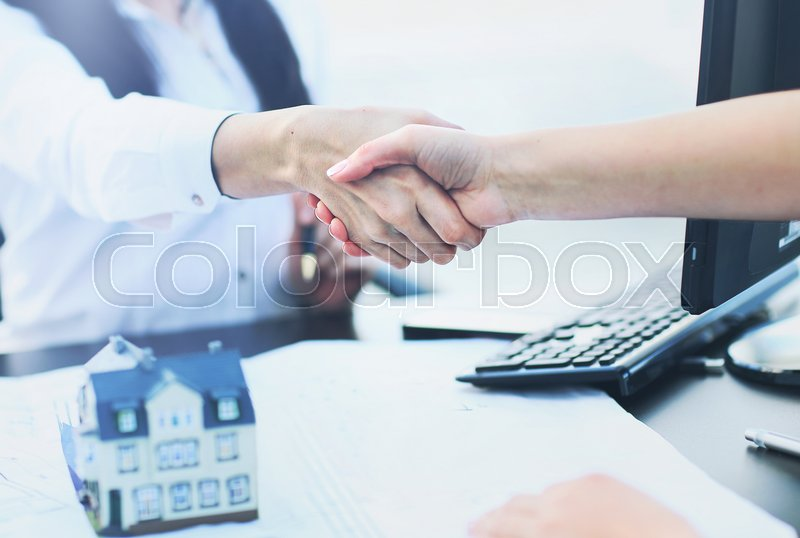 Agent shows a build project to a client, stock photo