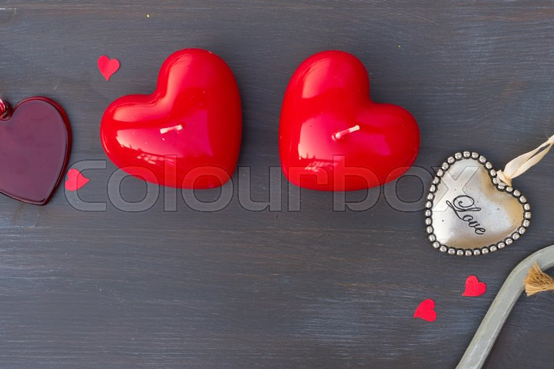 Valentines Day Hearts Border On Dark Wood Background Stock Photo