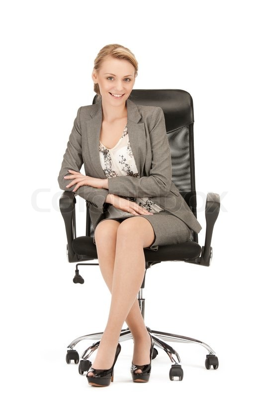 Picture of young businesswoman sitting in chair | Stock ...