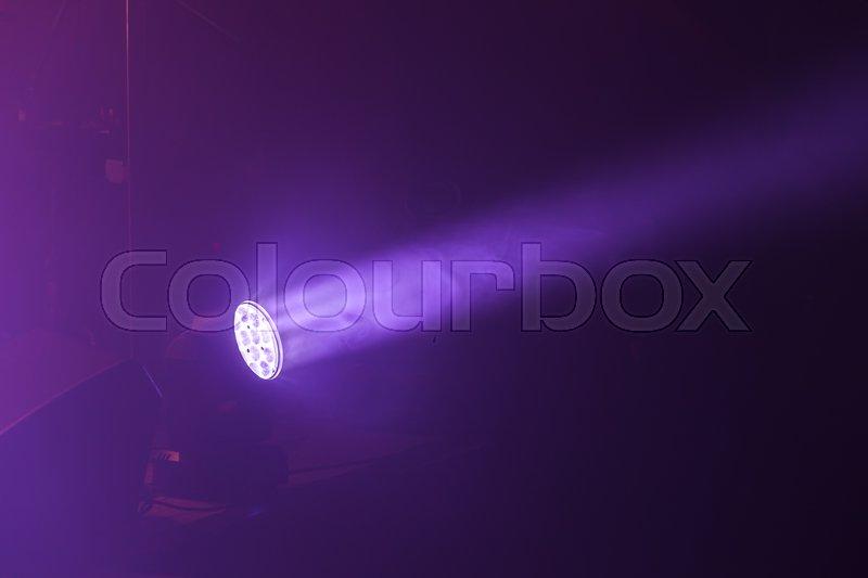 Stage LED spot light with purple beam, stage illumination equipment, stock photo