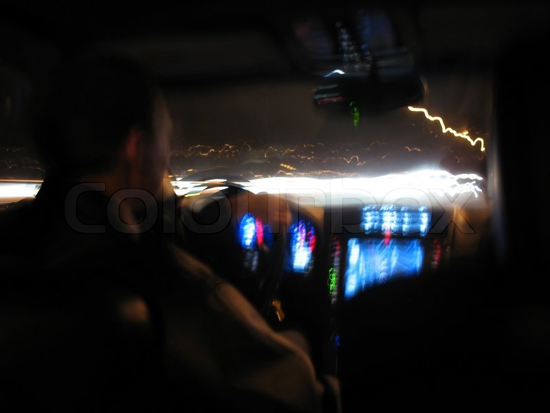 driving at night in a modern luxury car stock photo