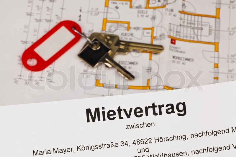 A lease and a plan in the German language Symbolic rental or purchase of dwellings, stock photo
