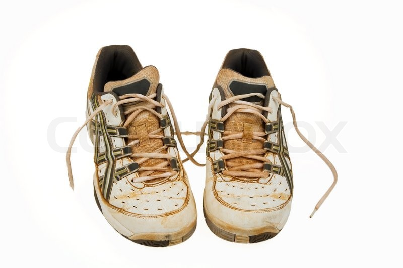 Old tennis shoes of a clay court Used athletic shoes, stock photo