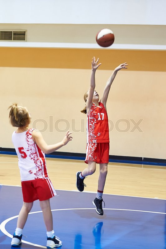 Girl athlete in sport uniform playing basketball , stock photo