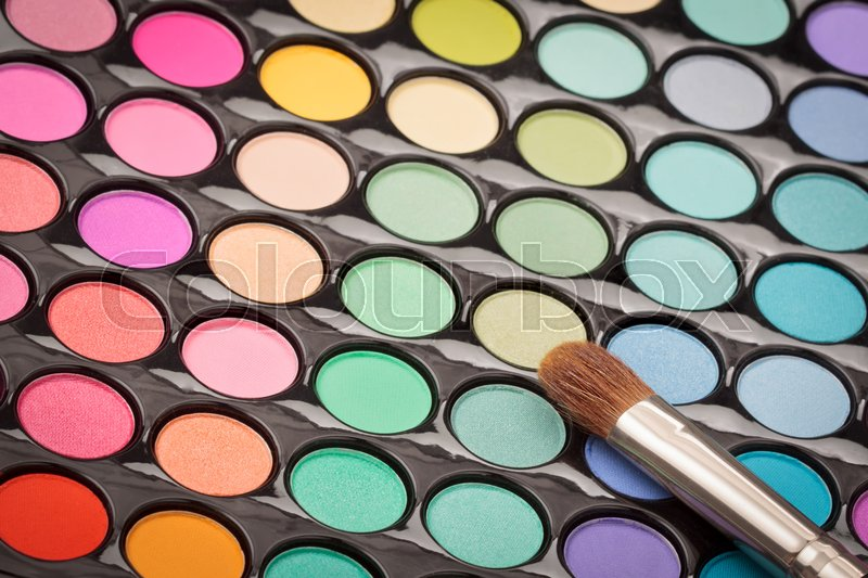 Beautiful makeup background. Makeup brush on colorful makeup palette with copyspace, stock photo