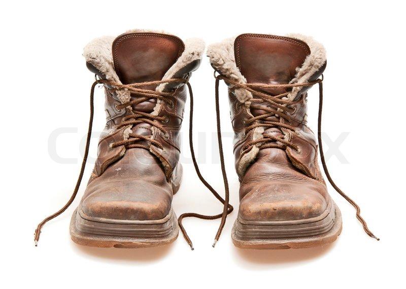 961a3591b16d Gamle brune støvler isoleret på hvidt
