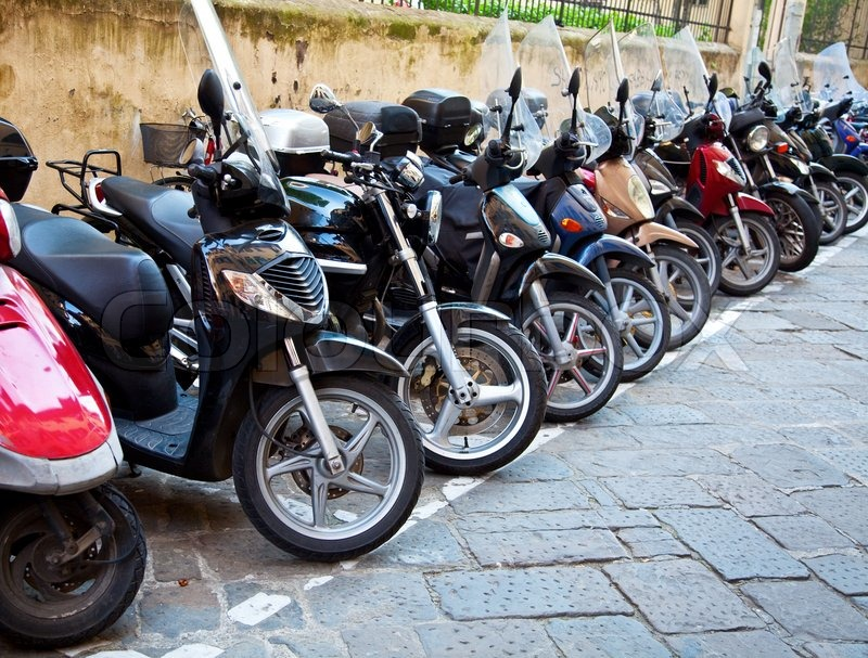 row of the motorcycles on the old street stock photo colourbox. Black Bedroom Furniture Sets. Home Design Ideas