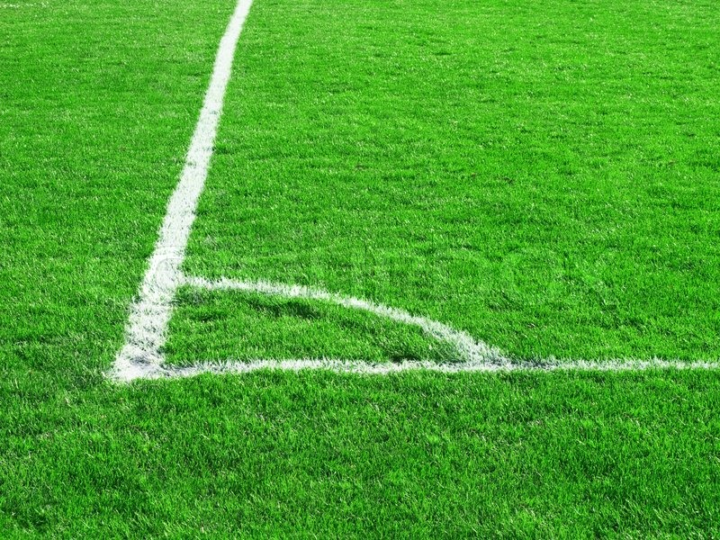 Green Grass Of The Football Soccer Field Stock Photo