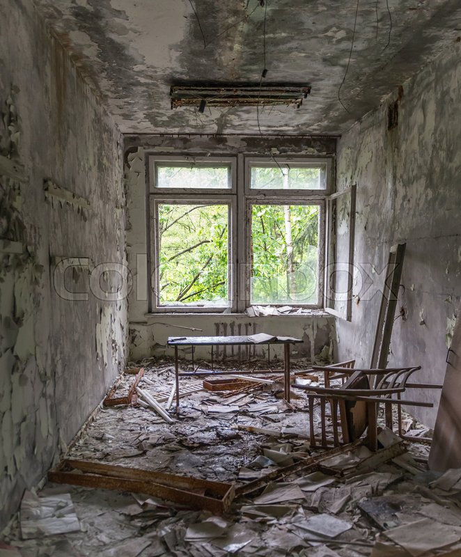 Abandoned school study with debris and broken furniture in Pripyat, stock photo