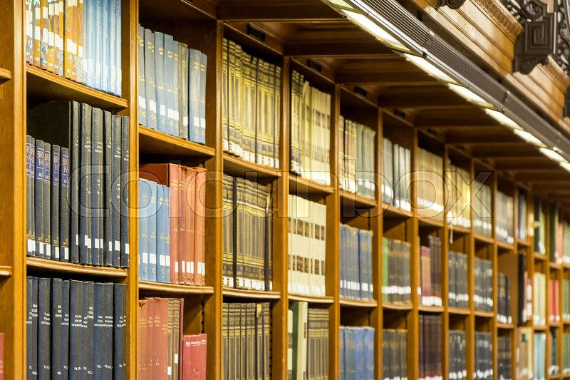 Ancient books on a wooden Bookshelf background, stock photo
