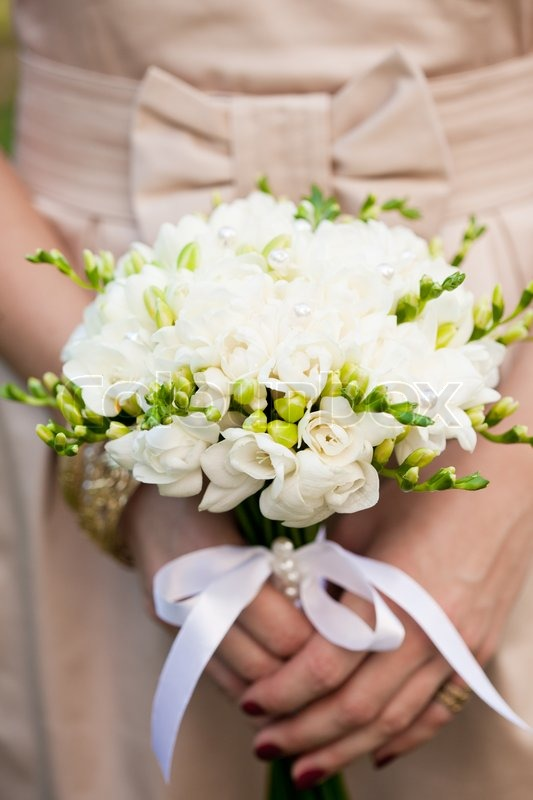 Wedding Bouquet From White Freesias Closeup In Bride S Hands Stock