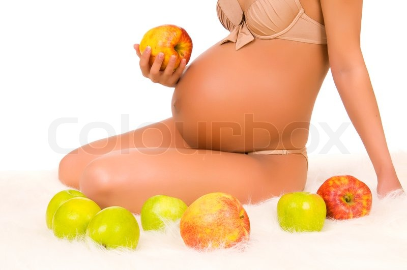 Stock image of 'Body pregnant woman with very big stomach, hand hold aple'