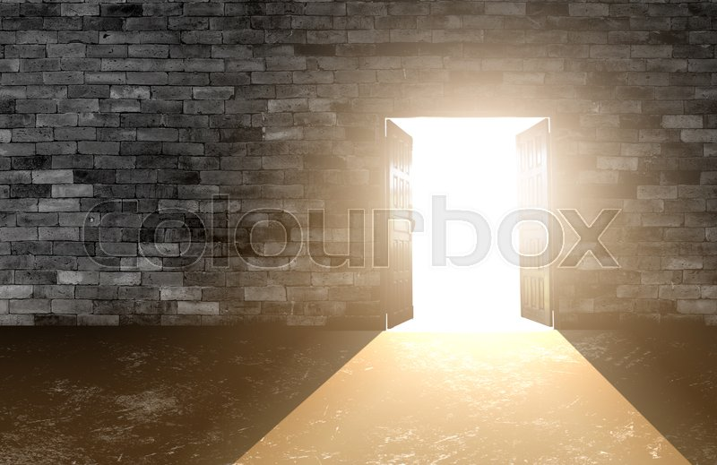 Wood doors opening with old cement wall and light coming in. background of old vintage white brick, stock photo