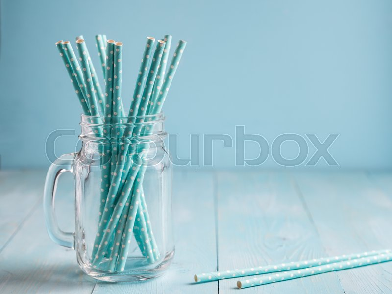 Mason jars with yellow paper straws and cap. Ideal for summer drinks and smoothies, stock photo