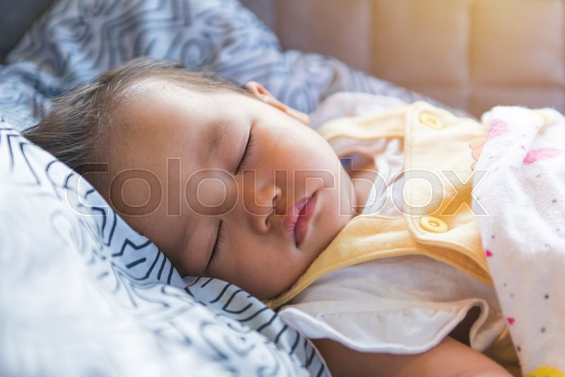 Portrait of sleeping baby, childhood and people concept, stock photo