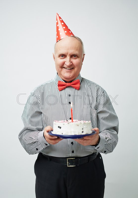 Portrait Of Charming Old Man In Party Hat And Bow Tie Standing