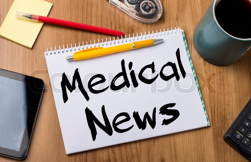 Medical News - Note Pad With Text On Wooden Table - with office tools, stock photo