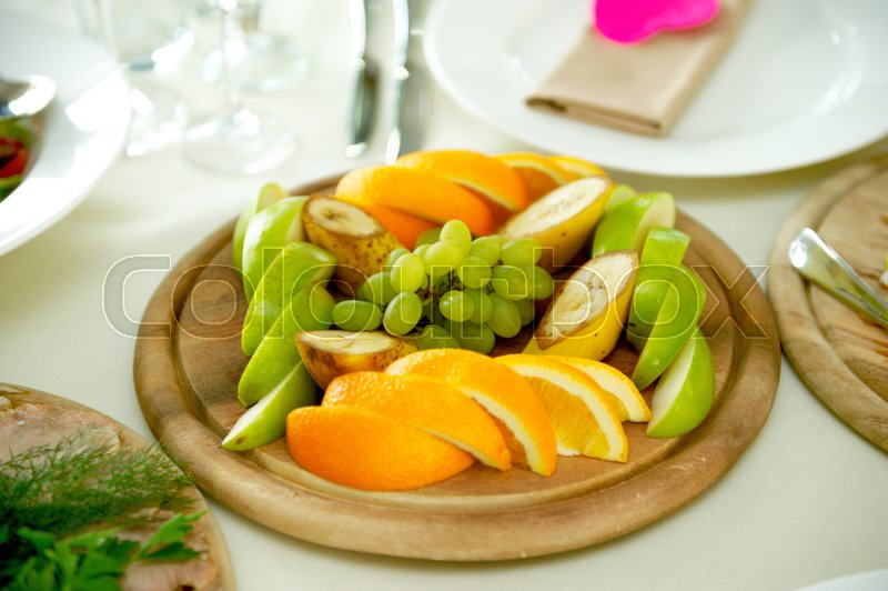 Fruit on the plate in restaurant. Banquet, stock photo