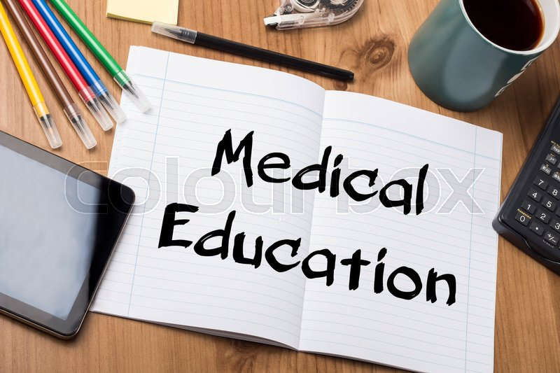 Medical Education - Note Pad With Text On Wooden Table - with office tools, stock photo