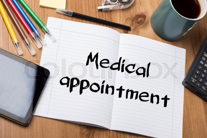 Medical appointment - Note Pad With Text On Wooden Table - with office tools, stock photo
