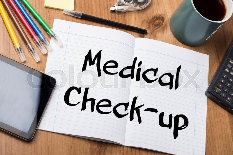 Medical Check-up - Note Pad With Text On Wooden Table - with office tools, stock photo