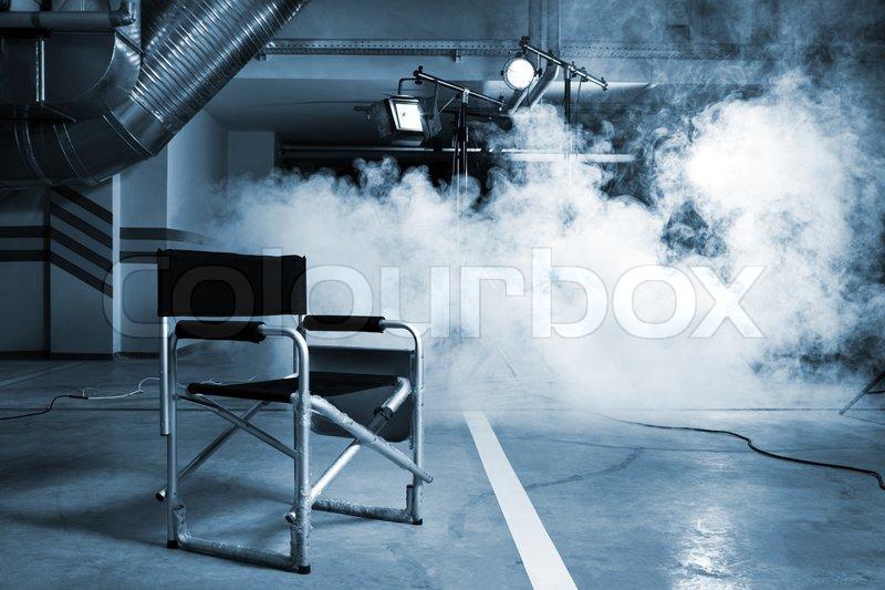 chair f r den regisseur im studio auf dem hintergrund eines rauch stockfoto colourbox. Black Bedroom Furniture Sets. Home Design Ideas