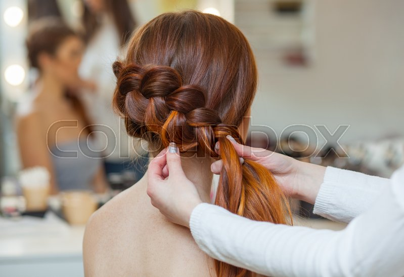 Beautiful Red Haired Hairy Girl Hairdresser Weaves A French Braid