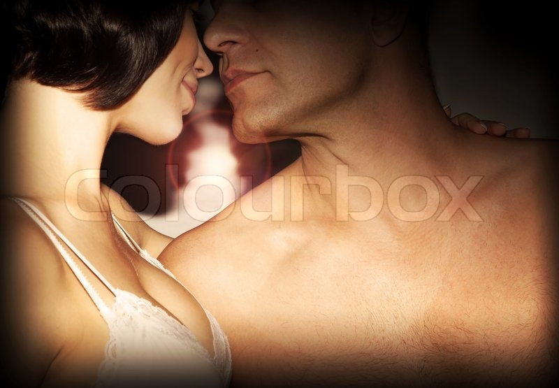 Stock image of 'Happy couple kissing, love, romance, passion, relationship of two young beautiful adult people'