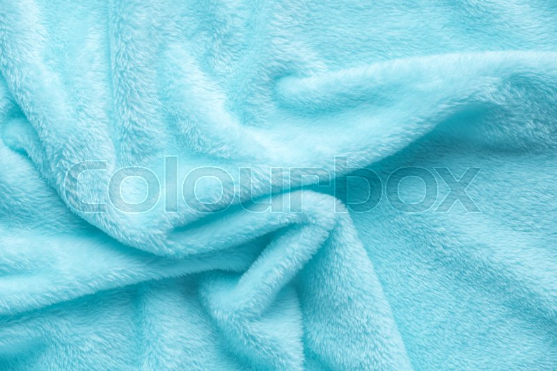 Tender blue texture of towel folded like background, close up, stock photo