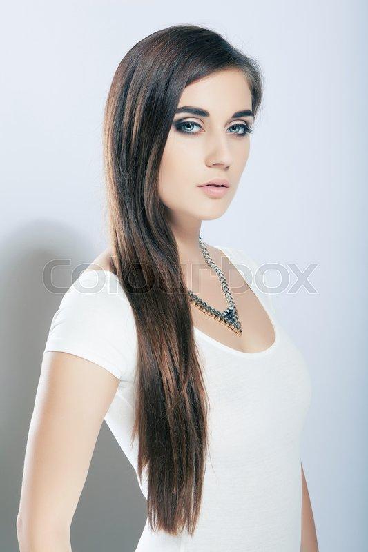 Portrait beautiful high key cute girl with long hair, blue eyes, stock photo