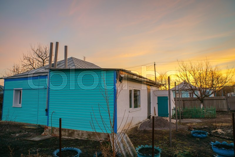House in the village at dawn in early spring, stock photo