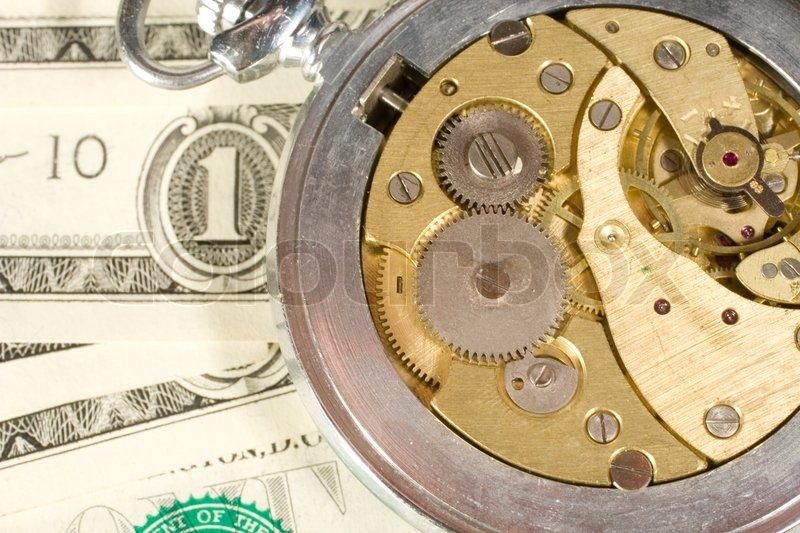 """Old watch mechanism and dollar bills (""""time is money"""" concept), stock photo"""