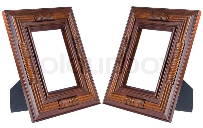 stock image of two dark brown wooden photo frames isolated on white with empty
