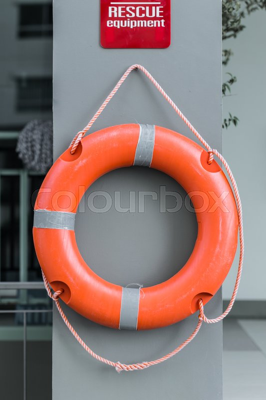Life Ring Orange Color Hanging At Wall Aside The Swimming Pool As Rescue Equipment Stock Photo