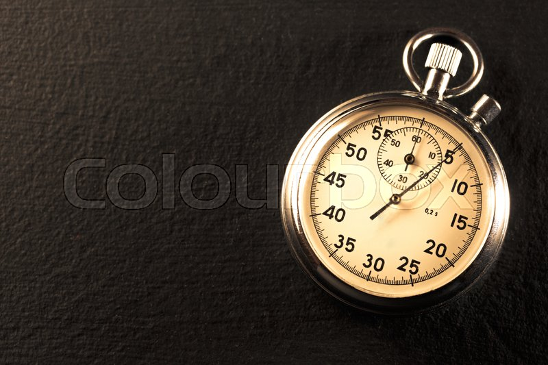 Stock image of 'Stopwatch on black background in closeup'