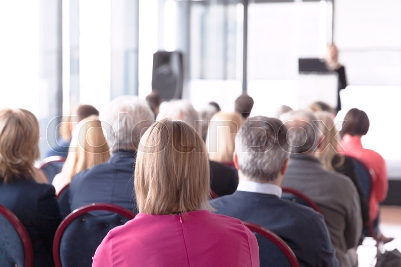Stock image of 'Participants at the business conference'