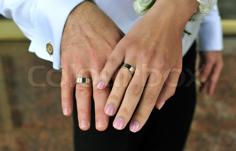 bride and groom holding hands with wedding rings on it stock photo colourbox - Wedding Rings On Hands