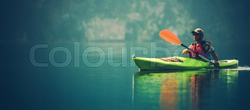 Kayak Water Sports Banner with Copy Space. Senior Kayaker on the Scenic Lake Panoramic Photo, stock photo