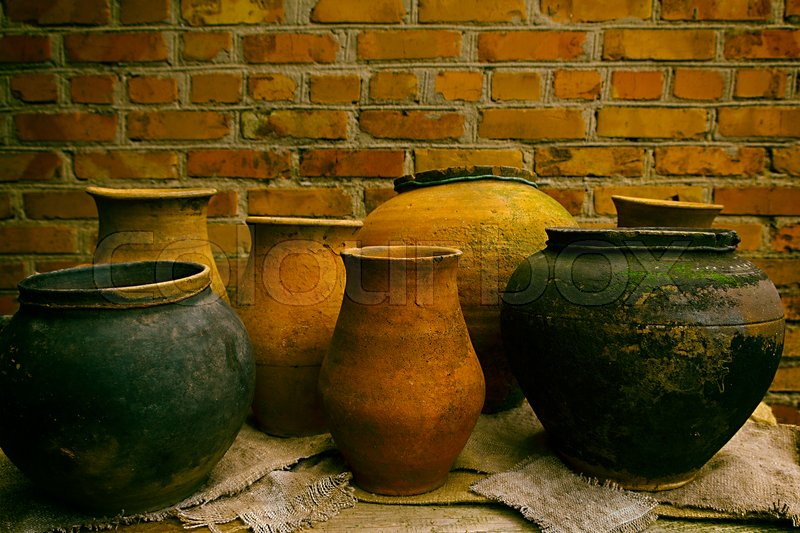Pottery Clay Pots Standing On A Wooden Table On A