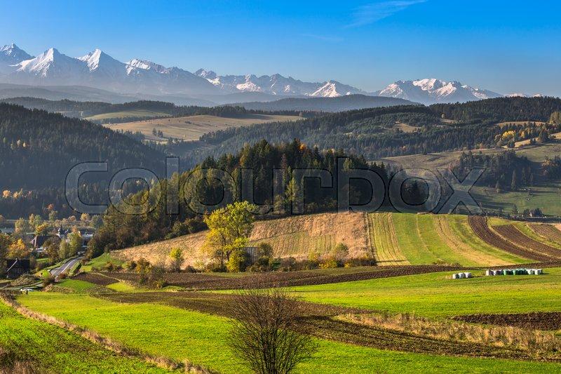 Tatra mountains in rural scene, Poland, stock photo