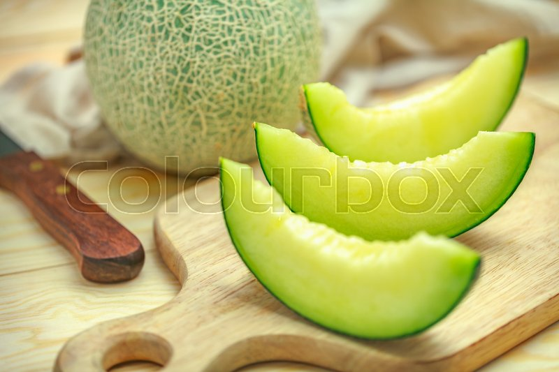 Fresh Sweet Green Melon On The Wooden Stock Image Colourbox While a green cantaloupe is definitely unripe, a yellow or tan cantaloupe may not be quite ripe yet. fresh sweet green melon on the wooden