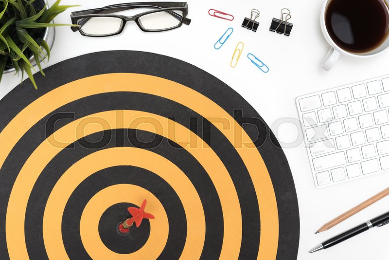 Dart Target Arrow Hitting On Bullseye In Dartboard Over Office Desk Table  Background With Eye Glasses, Pen, Pencil, Computer And Cup Of Coffee |  Stock Photo ...