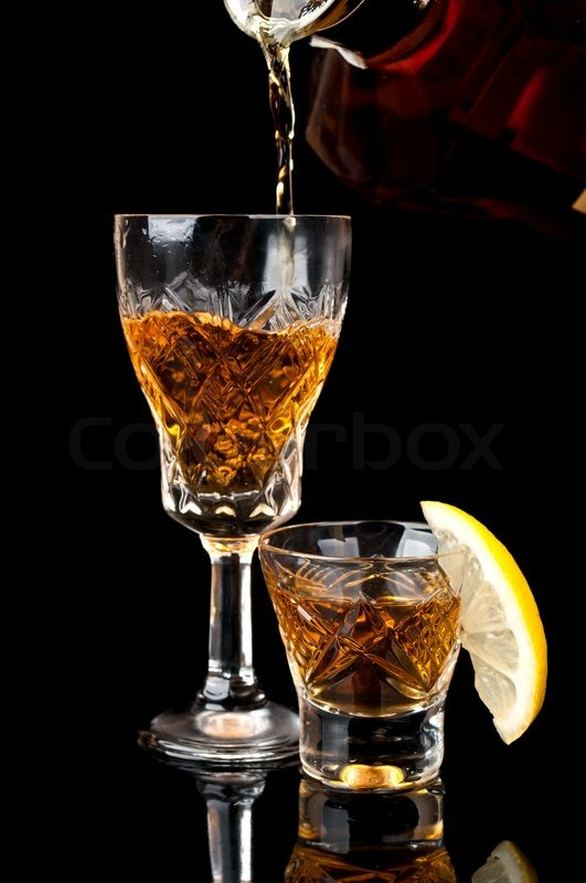http://www.colourbox.com/preview/2506514-752342-glass-of-cognac-with-lemon-isolated-on-a-black-background.jpg