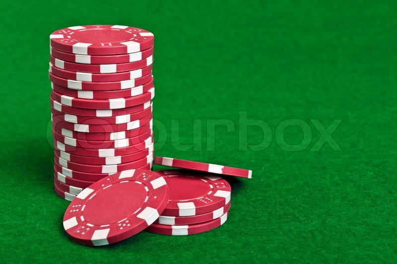 & Red poker chips on a green table background | Stock Photo | Colourbox