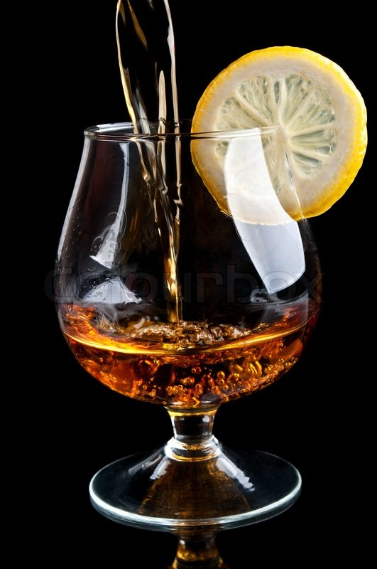 https://www.colourbox.com/preview/2507525-cognac-with-lemon-in-a-classic-glass-isolated-on-a-black-background.jpg