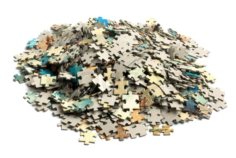 Pile Of Jigsaw Puzzle Pieces Jigsaw pieces being put